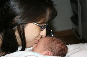 Gina kissing baby Jayden